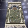 A prayer rug inspired by the carpet design of the Al-Rawdah Al-Sharifa in the Al-Nabawi Mosque